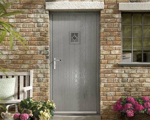 Grey door on sand brick wall & Distinction\u0027 Composite Doors Range | Sussex Door Company Pezcame.Com