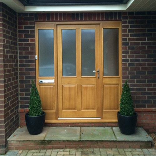 Oak front door against Sussex red bricks
